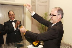 Michel Drappier pops open the Methuselah as Vinod Pandey applauds