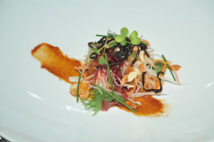 Chef Adrian Mellor's Oriental salad, pirikara sauce, miso and seaweed served with Cakebread Cellars Chardonnay 2009 at the Cakebread dinner at the Leela Palace, Bangalore