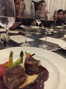 The herb crusted lamb in its delicious pan jus with the two mystery red wines